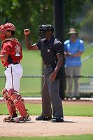 Umpire Jaylen Goodman calls a strike during a Gulf Coast League game between the GCL Astros and GCL Nationals on August 9, 2019 at FITTEAM Ballpark of the Palm Beaches training complex in Palm Beach, Florida.  GCL Nationals defeated the GCL Astros 8-2.  (Mike Janes/Four Seam Images)