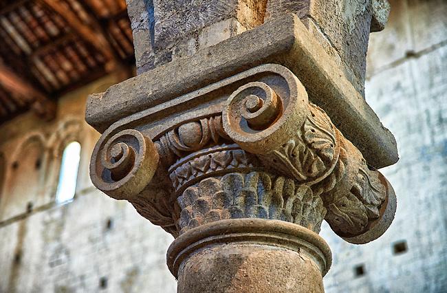 Romanesque column capital in the 8th century Romanesque Basilica church of St Peters, Tuscania, Lazio, Italy