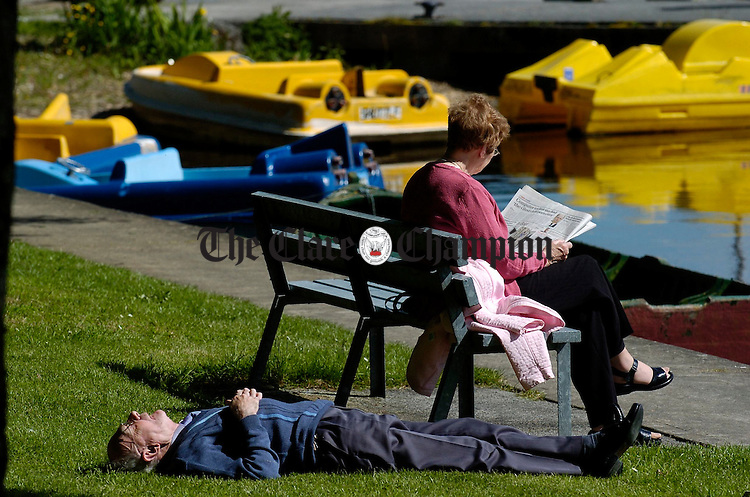 Enjoying the sunshine in Mountshannon harbour. Photograph by John Kelly. A couple make the most of the recent fine spell on the shore of Lough Derg at Mountshannon harbour. Photograph by John Kelly.