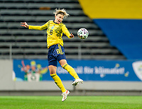 SOLNA, SWEDEN - APRIL 10: Lina Hurtig #8 of Sweden heads the ball during a game between Sweden and USWNT at Friends Arena on April 10, 2021 in Solna, Sweden.