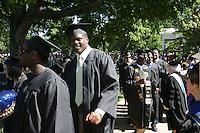 UVa football player at 2006 Graduation. Photo/Andrew Shurtleffgraduate celebrate happy