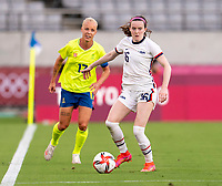 TOKYO, JAPAN - JULY 21: Rose Lavelle #16 of the USWNT dribbles the ball during a game between Sweden and USWNT at Tokyo Stadium on July 21, 2021 in Tokyo, Japan.