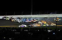 Jul. 2, 2011; Daytona Beach, FL, USA; NASCAR Sprint Cup Series drivers Mark Martin (5), Martin Truex Jr (56), Travis Kvapil (38), Clint Bowyer (33), Joe Nemechek (87), Landon Cassill (51), Regan Smith (78), Tony Stewart (14) and Brian Vickers (83) crash during the Coke Zero 400 at Daytona International Speedway. Mandatory Credit: Mark J. Rebilas-