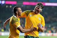 Kurtley Beale and Kane Douglas of Australia enjoy the moment as England become the first hosts not to make it through the pool stages during Match 26 of the Rugby World Cup 2015 between England and Australia - 03/10/2015 - Twickenham Stadium, London<br /> Mandatory Credit: Rob Munro/Stewart Communications