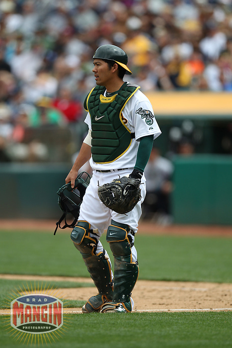 OAKLAND, CA - MAY 26:  Kurt Suzuki #8 of the Oakland Athletics works against the New York Yankees during the game at O.co Coliseum on Saturday May 26, 2012 in Oakland, California. Photo by Brad Mangin