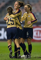 USWNT forward (8) Lauren Cheney celebrates her goal with teammates (25) Tina DiMartino and (5) Lindsay Tarpley during the Four Nations Tournament in  Guangzhou, China.  The US defeated Finland, 4-1.