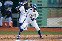 Jackson Martin (16) of the Seton Hall Pirates squares to bunt against the Cornell Big Red at The Ripken Experience on February 27, 2015 in Myrtle Beach, South Carolina.  The Pirates defeated the Big Red 3-0.  (Brian Westerholt/Four Seam Images)