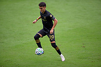 LOS ANGELES, CA - OCTOBER 25: Eduard Atuesta #20 of the Los Angeles FC moves with the ball during a game between Los Angeles Galaxy and Los Angeles FC at Banc of California Stadium on October 25, 2020 in Los Angeles, California.