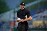 Umpire Mitch Trzeciak during a NY-Penn League game between the Lowell Spinners and Batavia Muckdogs on July 11, 2019 at Dwyer Stadium in Batavia, New York.  Batavia defeated Lowell 5-2.  (Mike Janes/Four Seam Images)
