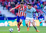 Jorge Resurreccion Merodio, Koke, of Atletico de Madrid (L) fights for the ball with Hugo Mallo Novegil of RC Celta de Vigo (R) during the La Liga 2017-18 match between Atletico de Madrid and RC Celta de Vigo at Wanda Metropolitano on March 11 2018 in Madrid, Spain. Photo by Diego Souto / Power Sport Images