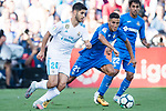 Marco Asensio of Real Madrid (L) fights for the ball with Faycal Fajr of Getafe CF (R) during the La Liga 2017-18 match between Getafe CF and Real Madrid at Coliseum Alfonso Perez on 14 October 2017 in Getafe, Spain. Photo by Diego Gonzalez / Power Sport Images
