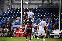 LAKE BUENA VISTA, FL - JULY 22: Daniel Royer #77 of the New York Red Bulls and Kendall Waston #2 of FC Cincinnati battle for the ball during a game between New York Red Bulls and FC Cincinnati at Wide World of Sports on July 22, 2020 in Lake Buena Vista, Florida.