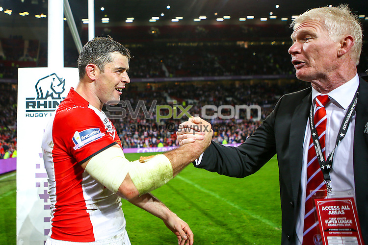 Picture by Alex Whitehead/SWpix.com - 11/10/2014 - Rugby League - First Utility Super League Grand Final - St Helens v Wigan Warriors - Old Trafford, Manchester, England - St Helens captain Paul Wellens celebrates with Chairman Eamonn McManus.