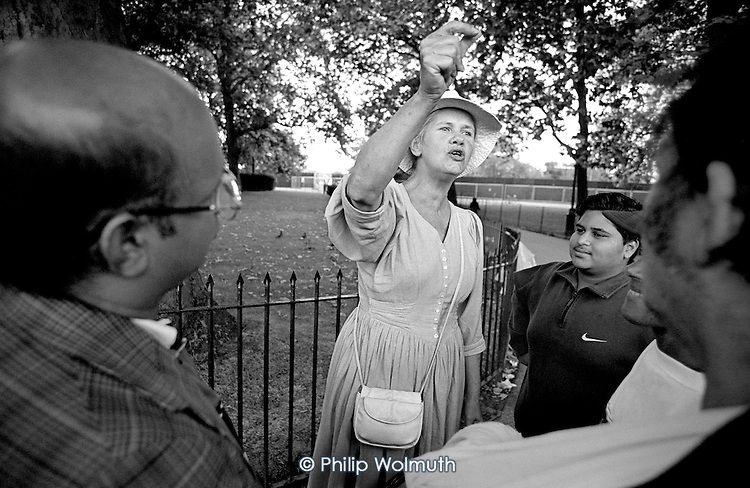Diane, a Christian who speaks on race and ethnicity, argues with hecklers at Speakers Corner, Hyde Park, London. Women speakers are very much in the minority