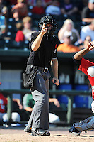 Umpire Jason Starkovich during a game between the Great Lakes Loons and Fort Wayne TinCaps on August 18, 2013 at Dow Diamond in Midland, Michigan.  Fort Wayne defeated Great Lakes 4-3.  (Mike Janes/Four Seam Images)