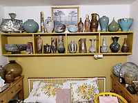 BNPS.co.uk (01202 558833)<br /> Pic: AdamPartridgeAuctioneers/BNPS<br /> <br /> Pictured: Main bedroom where their favourite pots were kept<br /> <br /> A huge collection of pottery and ceramics found stacked inside the suburban home of an elderly couple has sold for almost £200,000.<br /> <br /> Leonard and Alison Shurz filled every room of their three bed house with ceramic pieces they had gathered from all over the world.<br /> <br /> The Aladdin's Cave of pots, bowls, plates, vases and jugs was found by a stunned auctioneer who had the daunting task of cataloguing it all.