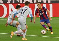 19th December 2020; Camp Nou, Barcelona, Catalonia, Spain; La Liga Football, Barcelona versus Valencia;  Pedri of Barcelona at full speed towards Gaya and Cheryshev of Valencia