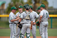 Dartmouth Big Green head coach Bob Whalen (2) talks with catcher Logan Adams (10), third baseman Steffen Torgersen (29), shortstop Nate Ostmo (5), second baseman Sean Sullivan (4), and first baseman Michael Calamari (3) while making a pitching change during a game against the USF Bulls on March 17, 2019 at USF Baseball Stadium in Tampa, Florida.  USF defeated Dartmouth 4-1.  (Mike Janes/Four Seam Images)