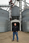 Darrel Gingerich, president and operations manager of Gingerich Farms in Lovington, Ill., shown with the company's stored grain. The white grain bags and metal bins allow the family company to wait and sell corn when the price is higher. <br /> Kristen Schmid for the Wall Street Journal