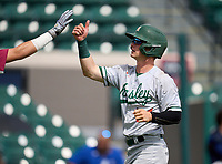 Mosley Dolphins Jaden  Rudd (24) fist bumps a teammate after scoring a run during the 42nd Annual FACA All-Star Baseball Classic on June 5, 2021 at Joker Marchant Stadium in Lakeland, Florida.  (Mike Janes/Four Seam Images)