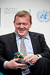 Prime Minister Lars Løkke Rasmussen holds  the lego pieces that he received from Kumi Naidoo, former director of the TckTckTck campaign, symbolizing a Fair Ambitious Binding treaty that needs to be achieved here in Denmark. (IMAGES free Editorial Web usage for Fresh Air Participants during COP 15. Credit: Robert vanWaarden)