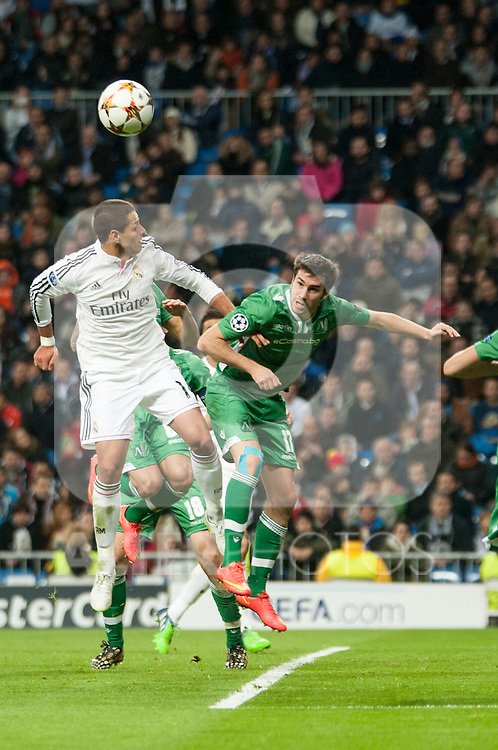 Chicharrito of Real Madrid and Abalo of Ludogorets during Champions League match between Real Madrid and Ludogorets at Santiago Bernabeu Stadium in Madrid, Spain. December 09, 2014. (ALTERPHOTOS/Luis Fernandez)