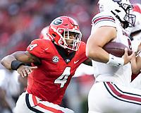 ATHENS, GA - SEPTEMBER 18: Nolan Smith #4 tracks down Zeb Noland #8 during a game between South Carolina Gamecocks and Georgia Bulldogs at Sanford Stadium on September 18, 2021 in Athens, Georgia.