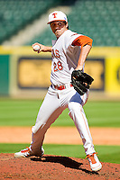 Relief pitcher Austin Dicharry #28 of the Texas Longhorns in action against the Arkansas Razorbacks at Minute Maid Park on March 4, 2012 in Houston, Texas.  The Razorbacks defeated the Longhorns 7-3.  Brian Westerholt / Four Seam Images