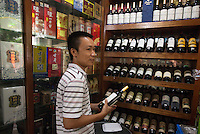 A wine trader is seen in his shop that sells real and fake wine, Guangzhou, Guangdong Province, China, 18 July 2014.<br /> <br /> PHOTO BY SINOPIX