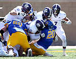 BROOKINGS, SD - APRIL 24: South Dakota State Jackrabbits running back Pierre Strong Jr. #20 is brought down by the defense from the Holy Cross Crusaders at Dana J Dykhouse Stadium on April 24, 2021 in Brookings, South Dakota. (Photo by Dave Eggen/Inertia)