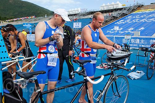 09 SEP 2011 - BEIJING, CHN - British visually impaired competitor  Iain Dawson (left) and his guide Liam Gentry prepare in transition for the start of the 2011 ITU World Paratriathlon Championships .(PHOTO (C) NIGEL FARROW)