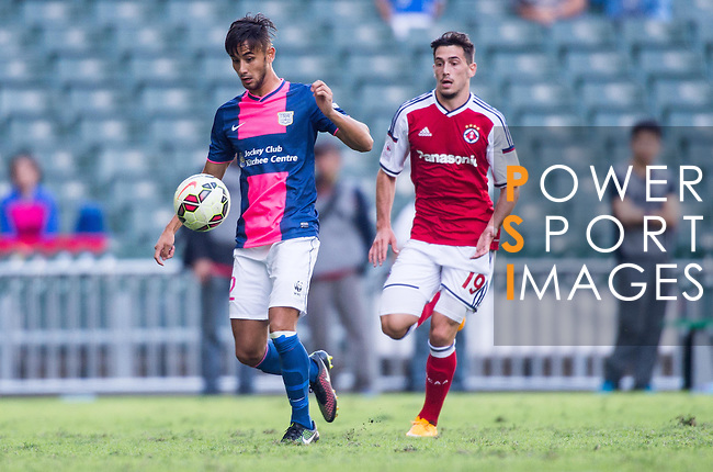 Emmet Chun Wan of Kitchee (L) being followed by Evan Kostopoulos of SCAA (R) during the HKFA Premier League between South China Athletic Association vs Kitchee at the Hong Kong Stadium on 23 November 2014 in Hong Kong, China. Photo by Aitor Alcalde / Power Sport Images