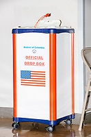 An official ballot drop box stands in the School without Walls High School Ward 2 polling location in the Foggy Bottom area of Washington, D.C., on Election Day, Tue., Nov. 3, 2020. Poll workers said that the polling location was pretty quiet most of the day due to substantial mail-in voting done in DC.