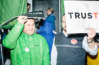 Supporters stand outside in the rain before Texas senator and Republican presidential candidate Ted Cruz speaks at The Village Trestle restaurant in Goffstown, New Hampshire, on Wed., Feb. 3, 2016.
