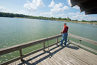Alan Miller of Fayetteville fishes for catfish using hot-dogs Monday Sept. 13, 2021 at Lake Fayetteville. Miller is semi-retired and tries to go fishing everyday. The National Weather Service is calling for high temperatures in the 80s this week with a slight chance of rain. Visit nwaonline.com/210000914Daily/  (NWA Democrat-Gazette/J.T. Wampler)