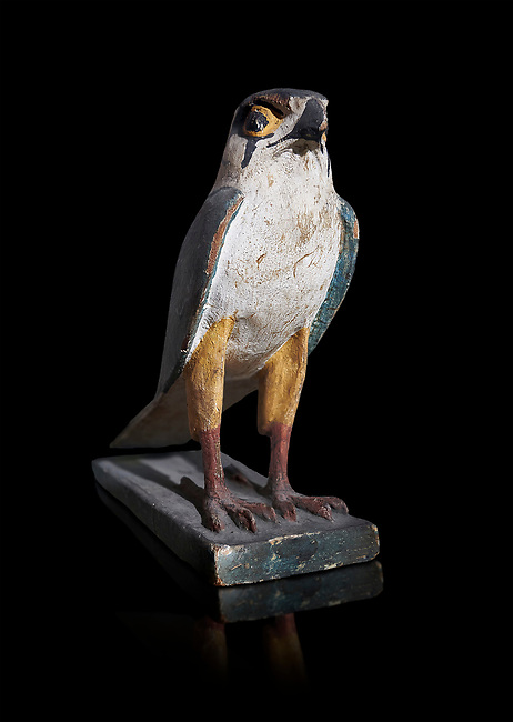 Ancient Egyptian wooden falcon bird, Late Period (722-322 BC). Egyptian Museum, Turin. black background. <br /> <br /> Wooden tomb models were an Egyptian funerary custom from the Middle Kingdom in which wooden figurines and sets were constructed to be placed in the tombs of Egyptian royalty. These wooden models represented the work of servants, farmers, other skilled craftsman, armies, and religious rituals