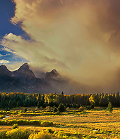 749450007v the sun filters through a magnificent cloud bank hovering above the teton range as viewed from blacktail ponds overlook in Grand Tetons National Park, Wyoming