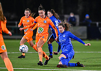Silke Vanwynsberghe (21) of AA Gent pictured in a duel with forward Hanne Merkelbach (25) of KRC Genk during a female soccer game between  Racing Genk Ladies and AA Gent Ladies on the eleventh matchday of the 2020 - 2021 season of Belgian Scooore Womens Super League , friday 22 th of January 2021  in Genk , Belgium . PHOTO SPORTPIX.BE | SPP | DAVID CATRY