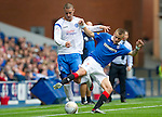 Rangers v St Johnstone....28.08.10  .Marcus Haber battles with Vladimir Weiss.Picture by Graeme Hart..Copyright Perthshire Picture Agency.Tel: 01738 623350  Mobile: 07990 594431
