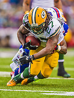 14 December 2014: Green Bay Packers running back Eddie Lacy takes a shovel pass forward before being tackled one yard short of the line of scrimmage in the second quarter against the Buffalo Bills at Ralph Wilson Stadium in Orchard Park, NY. The Bills defeated the Packers 21-13, snapping the Packers' 5-game winning streak and keeping the Bills' 2014 playoff hopes alive. Mandatory Credit: Ed Wolfstein Photo *** RAW (NEF) Image File Available ***