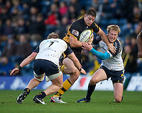 Tom Lindsay of London Wasps is tackled by Jake Abbott (left) and Joe Carlisle of Worcester Warriors during the LV= Cup second round match between London Wasps and Worcester Warriors at Adams Park on Sunday 18th November 2012 (Photo by Rob Munro)