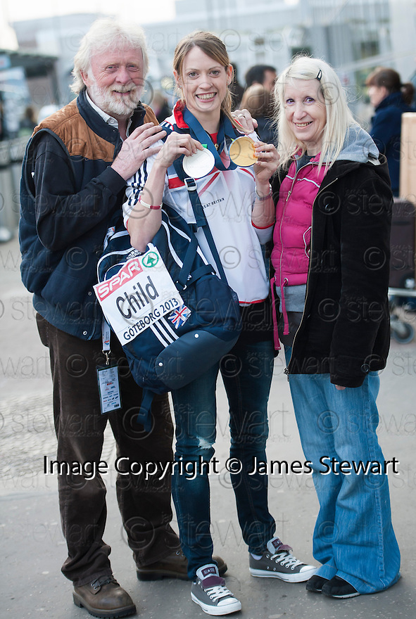 Scots athlete Eilidh Child is greeted by her Dad Ronnie and Mum Gill on her return to Edinburgh Airport after her double medal winning performance at the European Indoor Championships in Gothenburg.