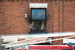 © Joel Goodman - 07973 332324 . 08/07/2017 . Bolton , UK . Scene on Rosamond Street in Daubhill , where a fatal house fire burned through a mid-terrace house this morning (Saturday 8th July 2017) . Firefighters responded at 9am this morning (Saturday 8th July 2017) . A family of five are reported to have been inside at the time and there are understand to me multiple fatalities . Photo credit : Joel Goodman