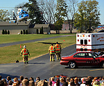 """PIQUA - Students at Piqua High School assembled behind the Piqua Junior High School to witness a mock crash on Friday. <br /> The event, sponsored by the FCCLA was held to educate students on the dangers of driving under the influence as well as speed and inattentive driving.<br /> Officers from the Piqua Police Department and the Ohio Highway Patrol investigated the """"scene"""" as they would a real crash. The Piqua Fire Department and medic, along with """"mutual aide"""" from the Casstown Fire Department, operated as they would at the scene of a similar crash. CareFlight responded to remove on """"victim"""" while Jamison & Yannucci Funeral Home took care of the duties of removing the """"body"""" of one of the crash """"victims"""".<br /> In closing the event, the mother of former area student Jason Segar spoke to students. Segar described the day her son died in a crash several years ago at the hands of a driver who had been huffing.<br /> Students were encouraged to not drink and drive and to always devote 100% of their attention to driving when behind the wheel.<br /> The event coincides with this weekend's homecoming in Piqua."""