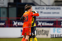 20th February 2021; Dens Park, Dundee, Scotland; Scottish Championship Football, Dundee FC versus Queen of the South; Ayo Obileye of Queen of the South celebrates at the end of the match with Rohan Ferguson