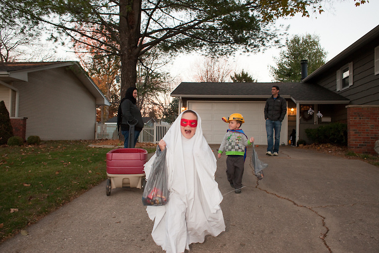 At ages six and three, my sons were a ghost and Batman with a miner's helmet for Halloween.
