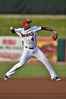 Tennessee Smokies shortstop Addison Russell #4 warms up between innings during a game against the Jacksonville Suns at Smokies Park July 10, 2014 in Kodak, Tennessee. The Suns defeated the Smokies 6-5. (Tony Farlow/Four Seam Images)