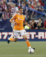 Houston Dynamo midfielder Geoff Cameron (20) brings the ball forward. In a Major League Soccer (MLS) match, the New England Revolution tied Houston Dynamo, 2-2, at Gillette Stadium on May 19, 2012.