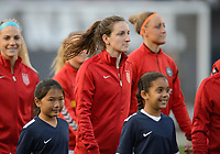 San Diego, Ca - Sunday, January 21, 2018: Andi Sullivan and Player Escorts during a USWNT 5-1 victory over Denmark at SDCCU Stadium.