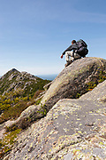 A hiker enjoys the view of Mount Chocorua from Middle Sister Trail in the White Mountains, New Hampshire USA